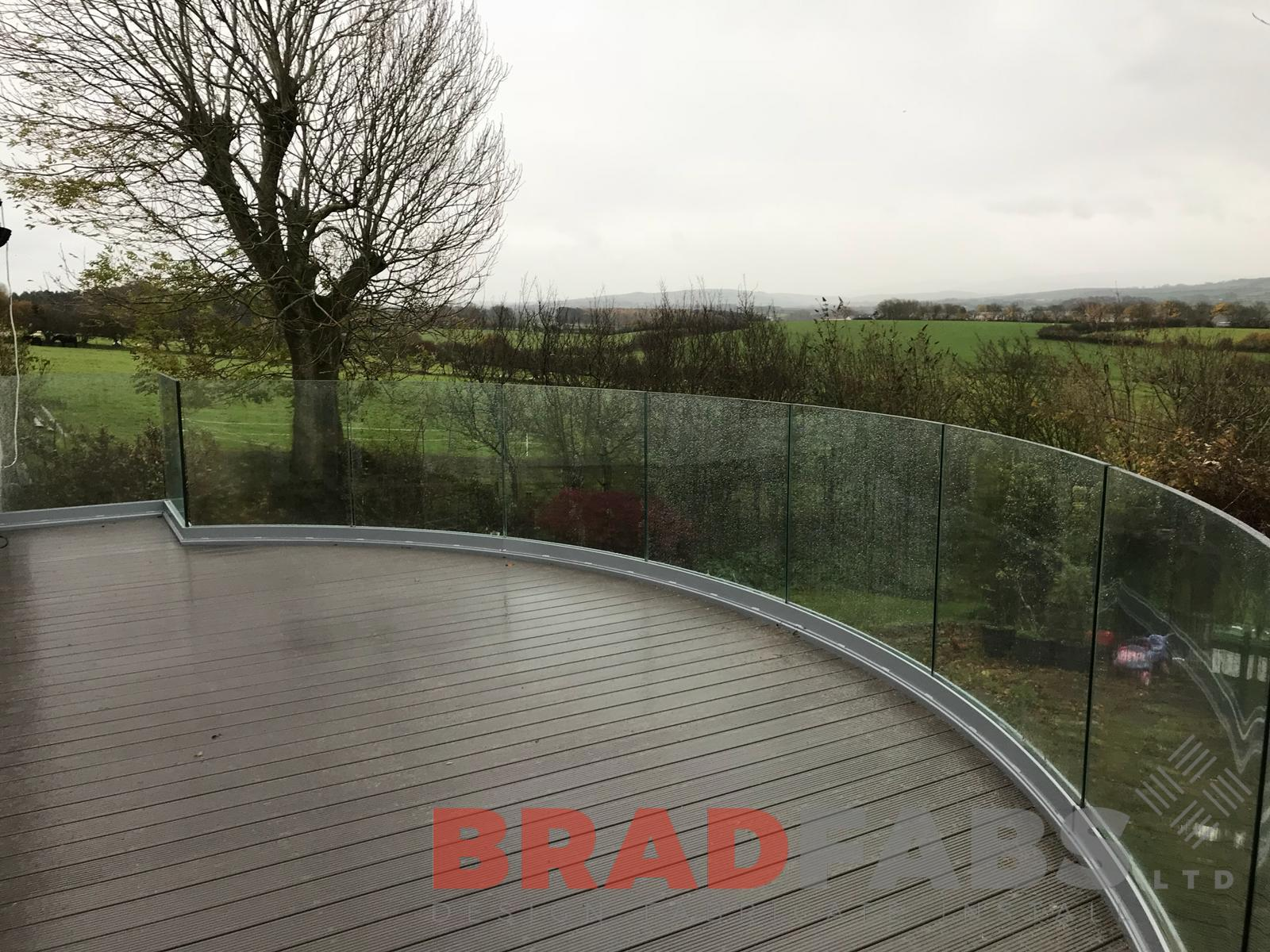 Curved infinity glass balcony with helix staircase by Bradfabs