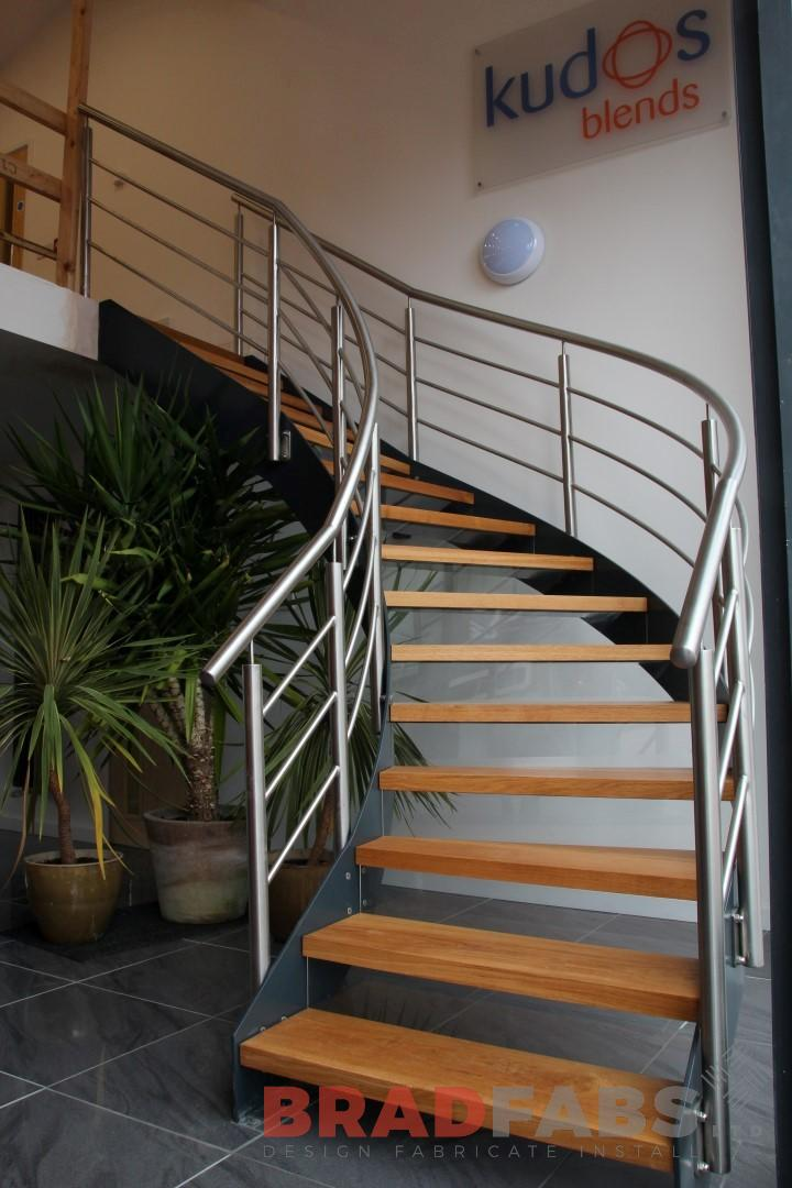 Curved brushed steel staircase