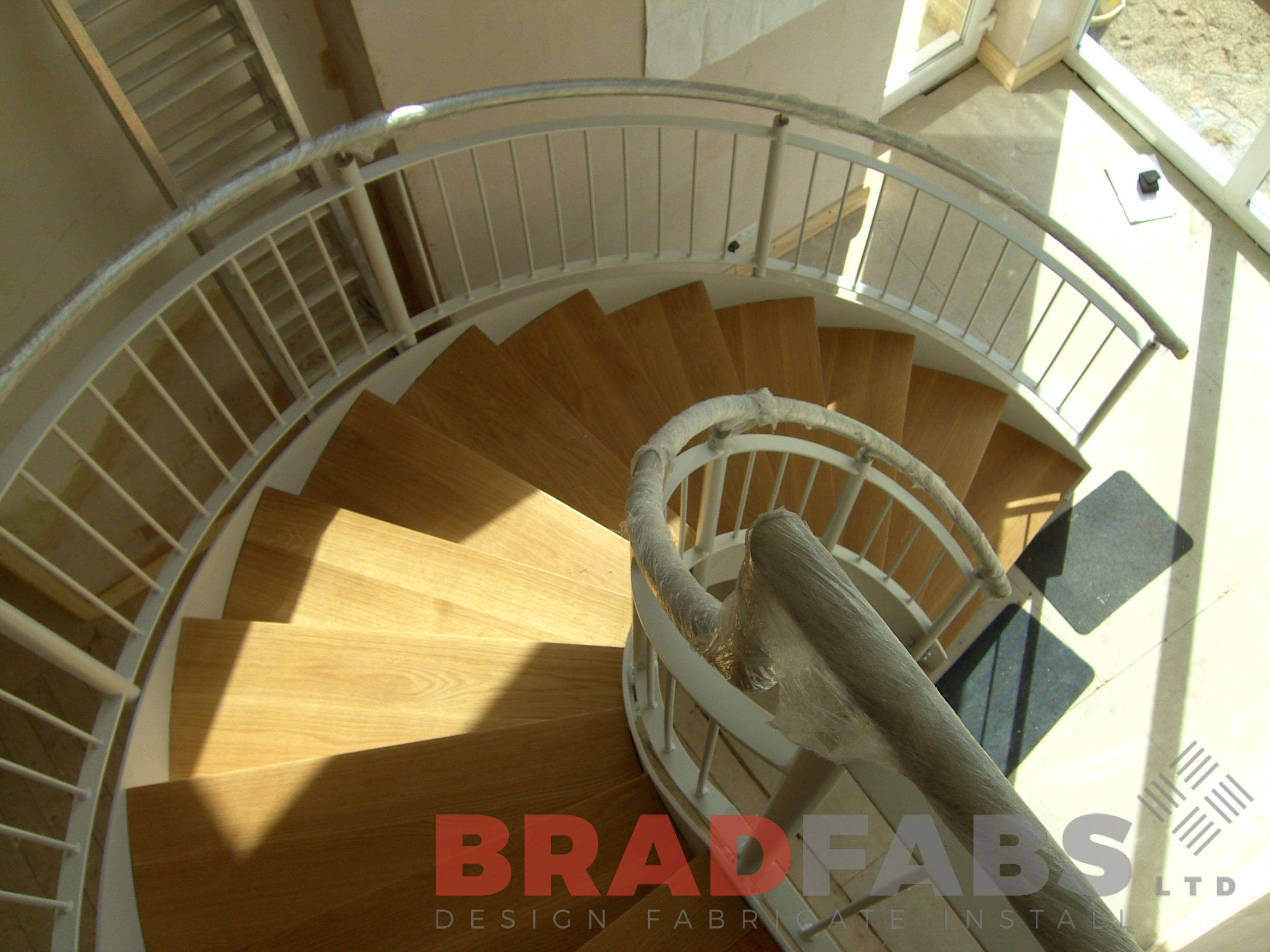 Wooden treads on helix internal staircase by Bradfabs