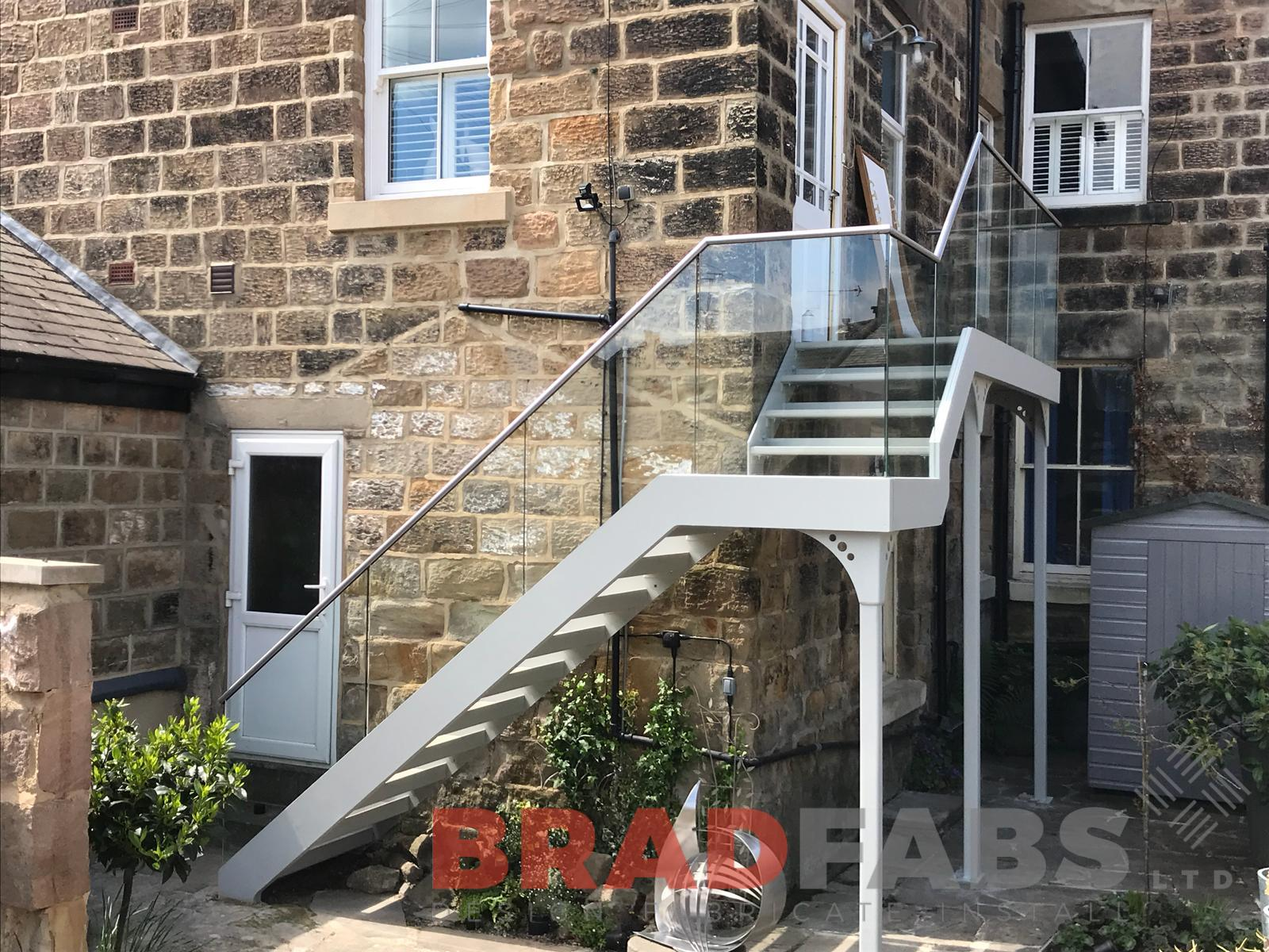 Access Staircase in mild steel, galvanised and powder coated with glass balustrade