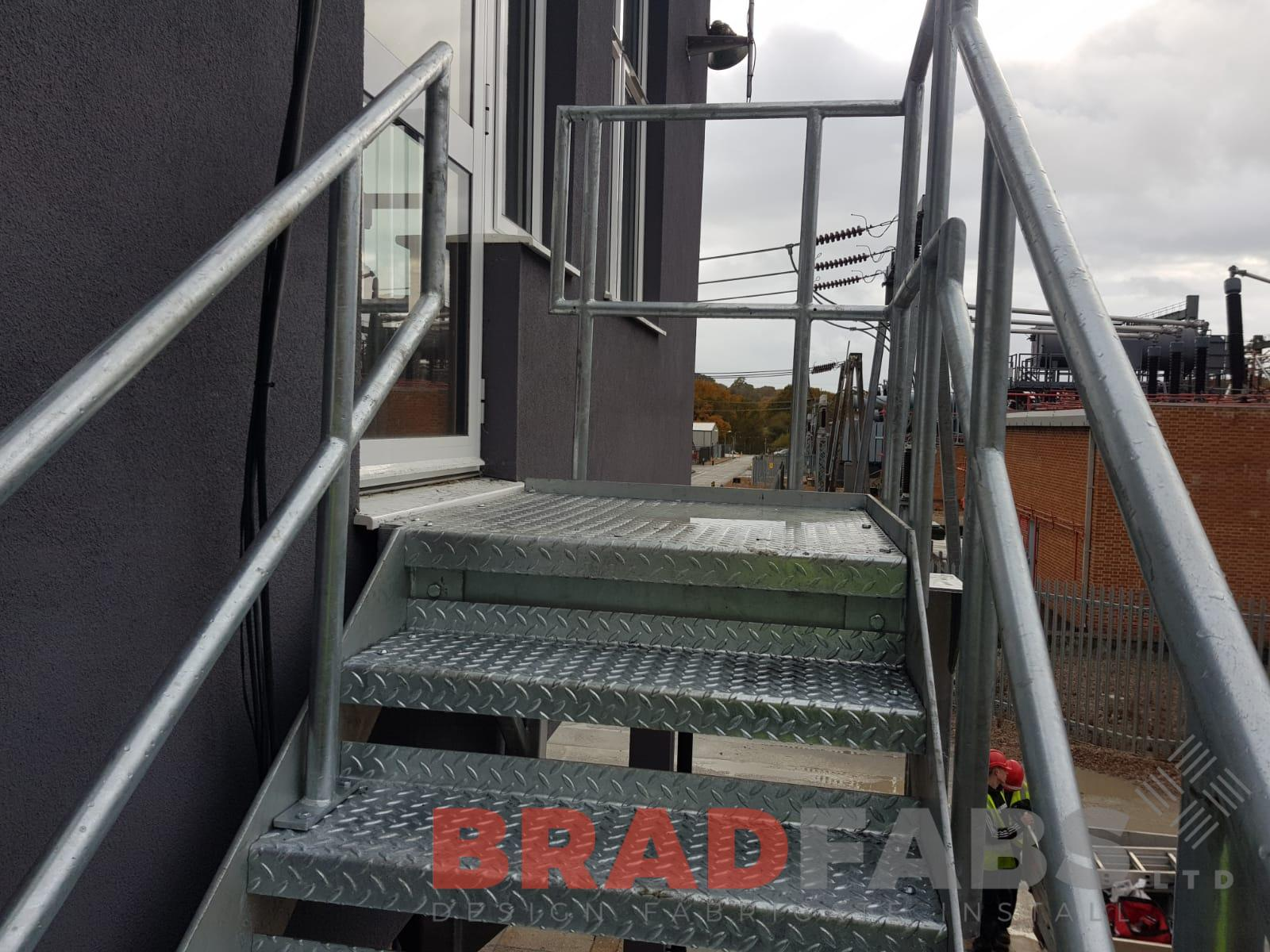 Mid and top rail balustrade with durbar treads, designed, fabricated and installed by Bradfabs
