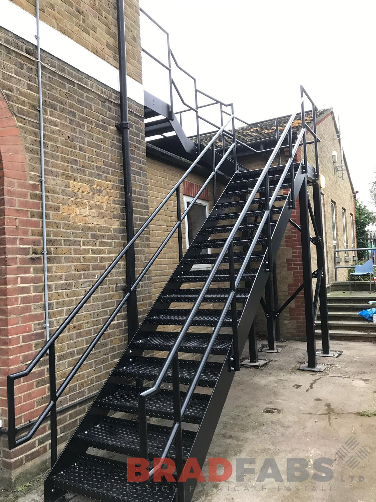 External straight staircase for a college building, manufactured in mild steel, galvanised to protect against all weather conditions, and powder coated to colour of customers choice, by Bradfabs