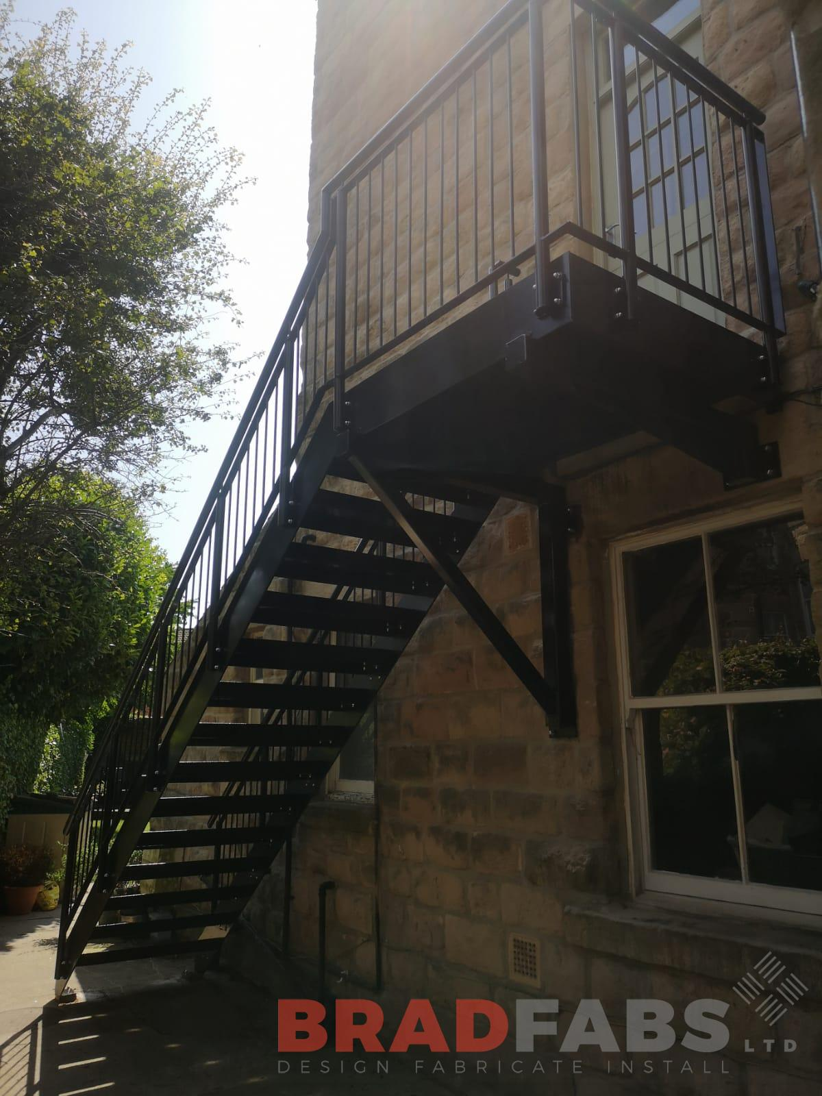 Mild steel, galvanised and powder coated fire escape with vertical bar balustrade and durbar treads by Bradfabs