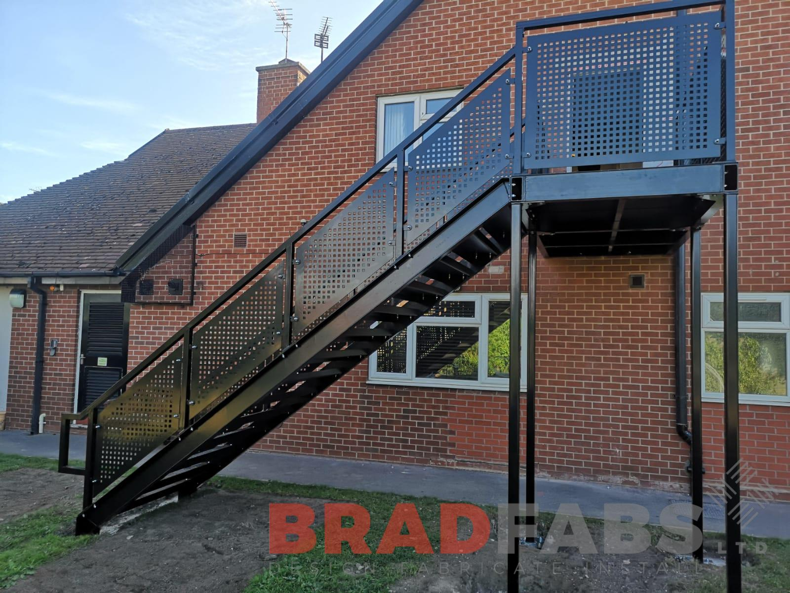 Mild steel, galvanised and powder coated black fire escape with perforated balustrade and complete with durbar treads by Bradfabs