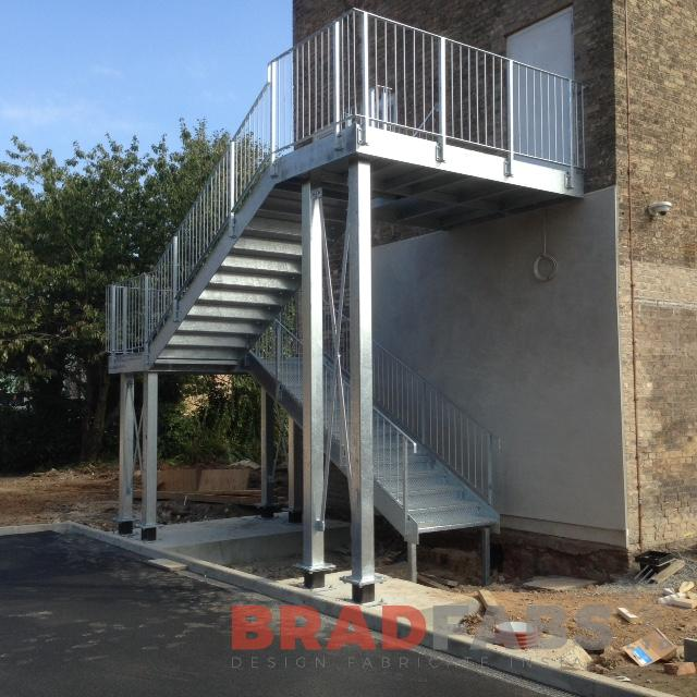 Bespoke mild steel and galvanised fire escape for a commercial property by Bradfabs