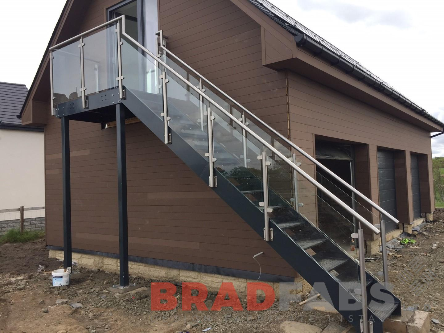 large straight external staircase in mild steel, galvanised and powder coated with durbar treads, glass infill panels and stainless steel balustrade by Bradfabs Ltd