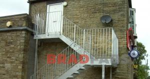 Steel external straight fire escape with two landings designed and installed by Bradfabs UK