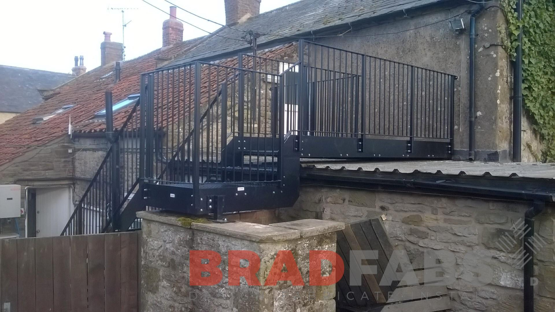 Unique designed straight fire escape manufactured and installed by Bradfabs