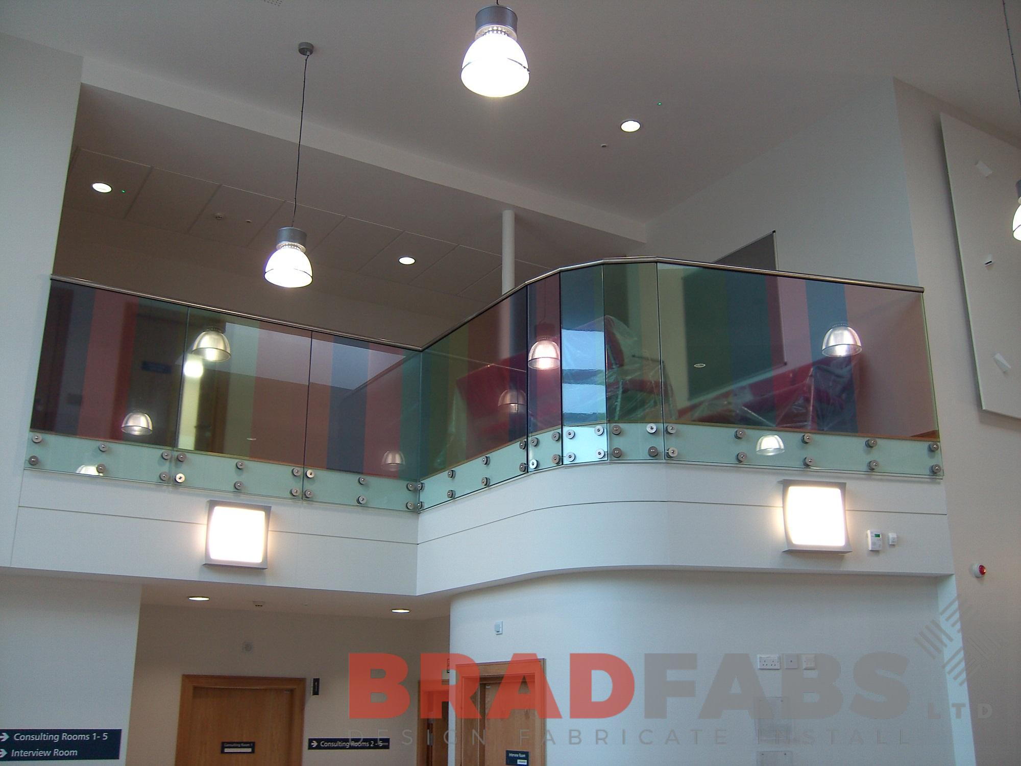 colourful decorative balustrade with stainless steel handrail