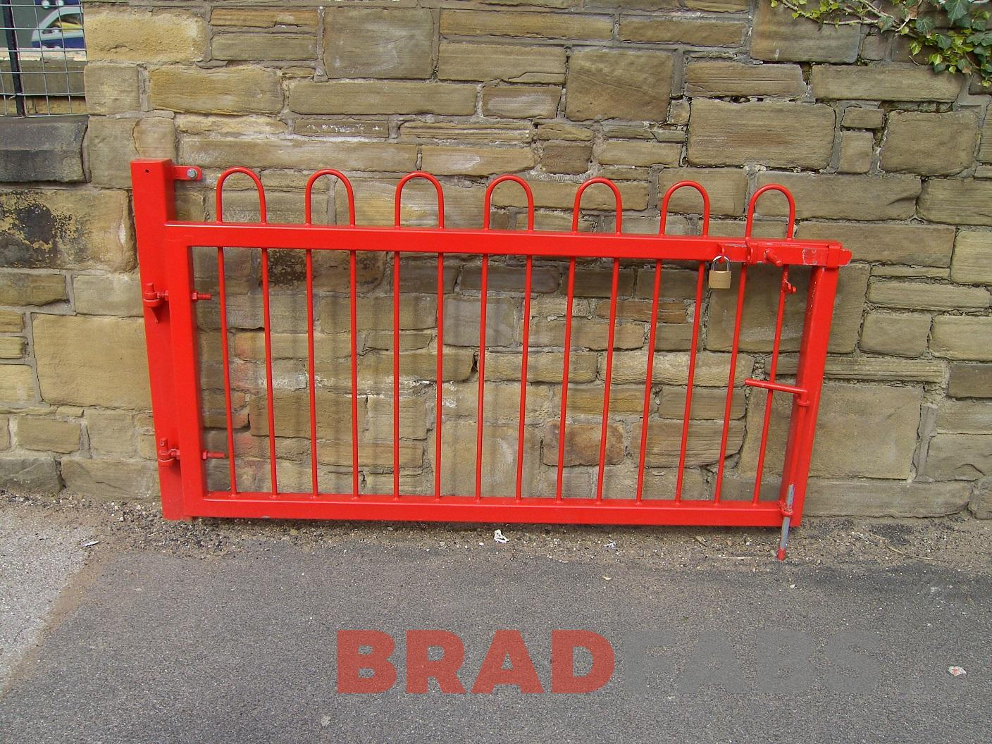 Bespoke mild steel, galvanised and powder coated red gates for a primary school by Bradfabs Ltd