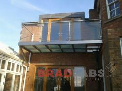 Bradfabs fabricated this stainless and glass floor balcony Rugby, UK