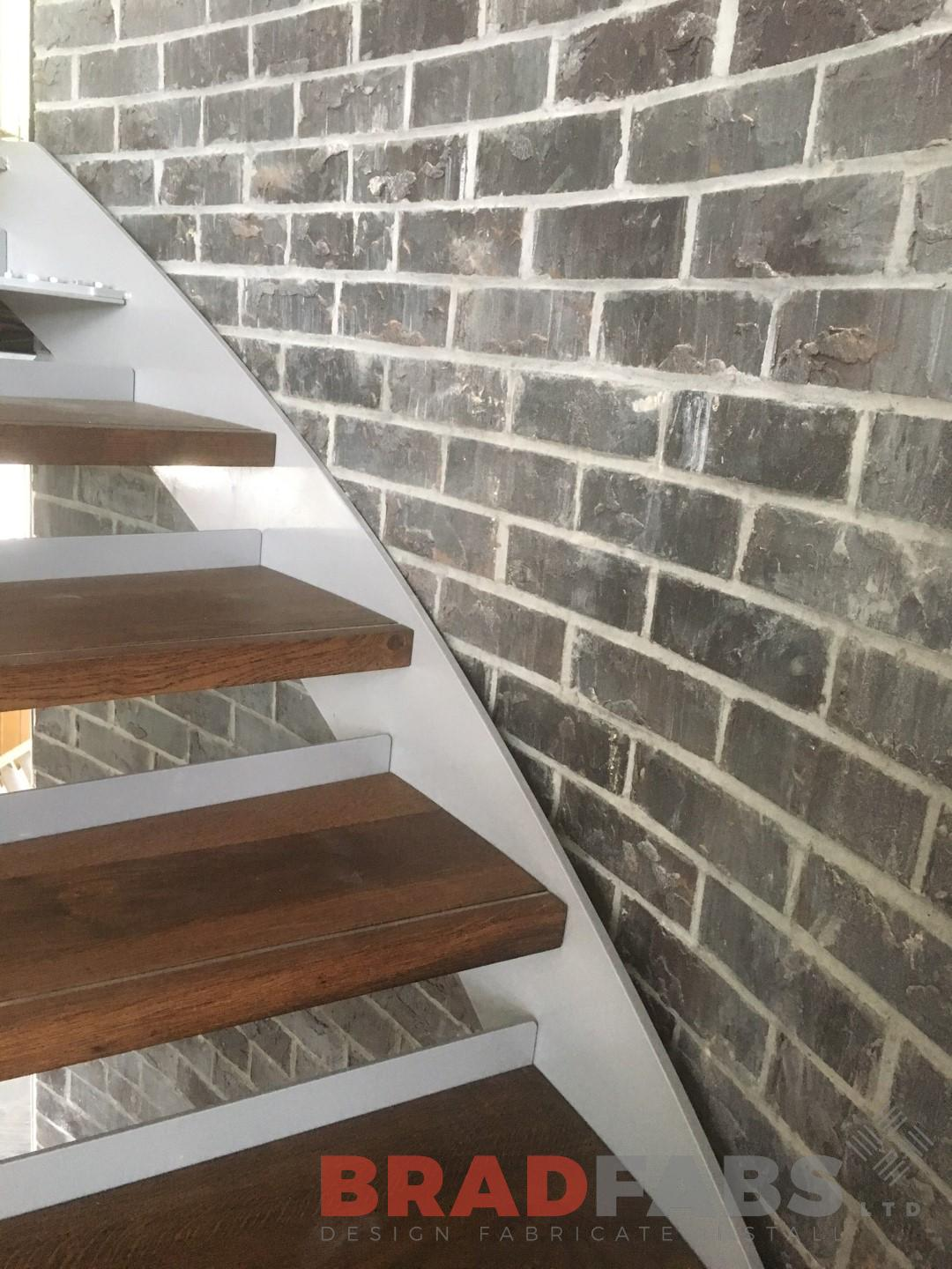 Oak treads on staircase installed by Bradfabs