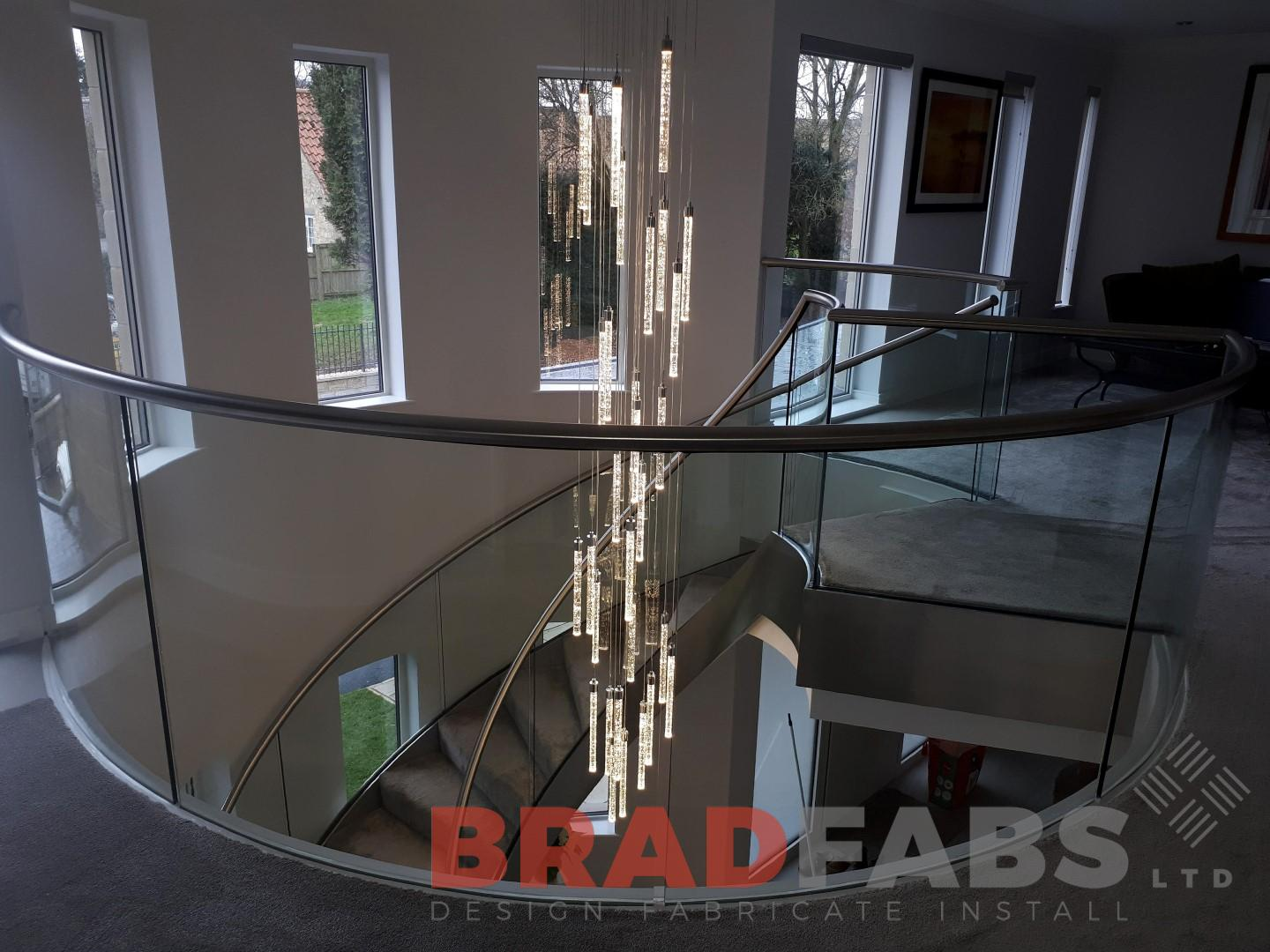 Stainless steel and glass balustrade round landing by Bradfabs