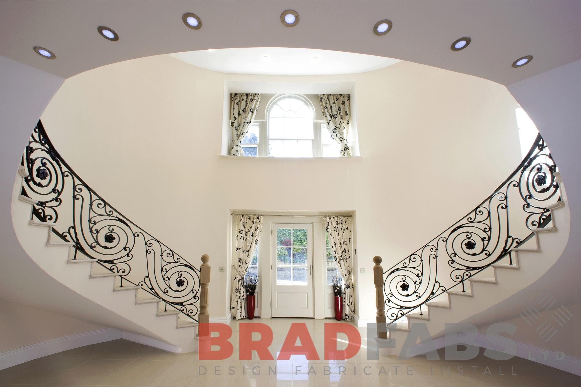 Curved high quality helix staircase with ornate balustrade
