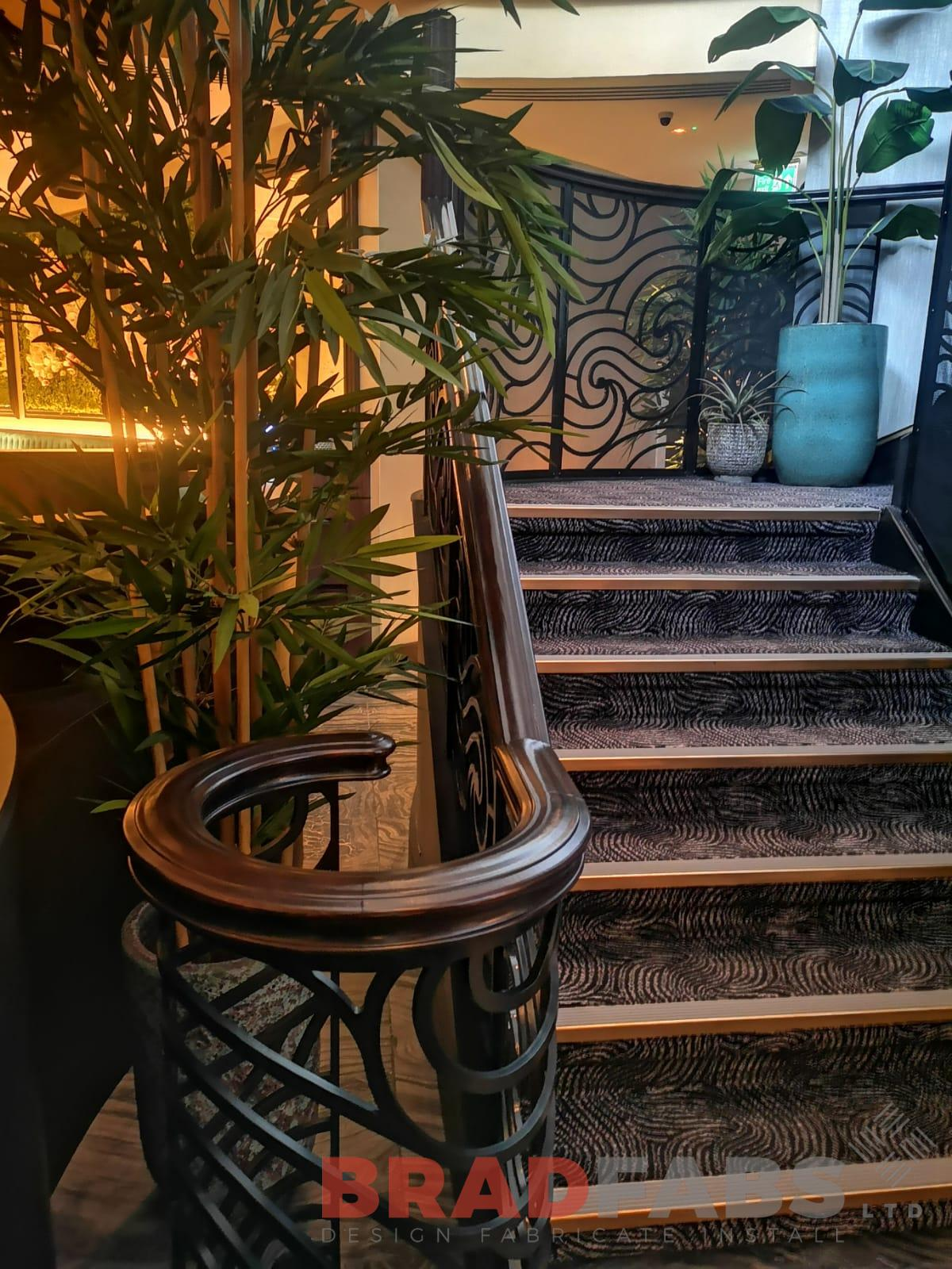 Curved helical staircase with ornate balustrade by Bradfabs UK