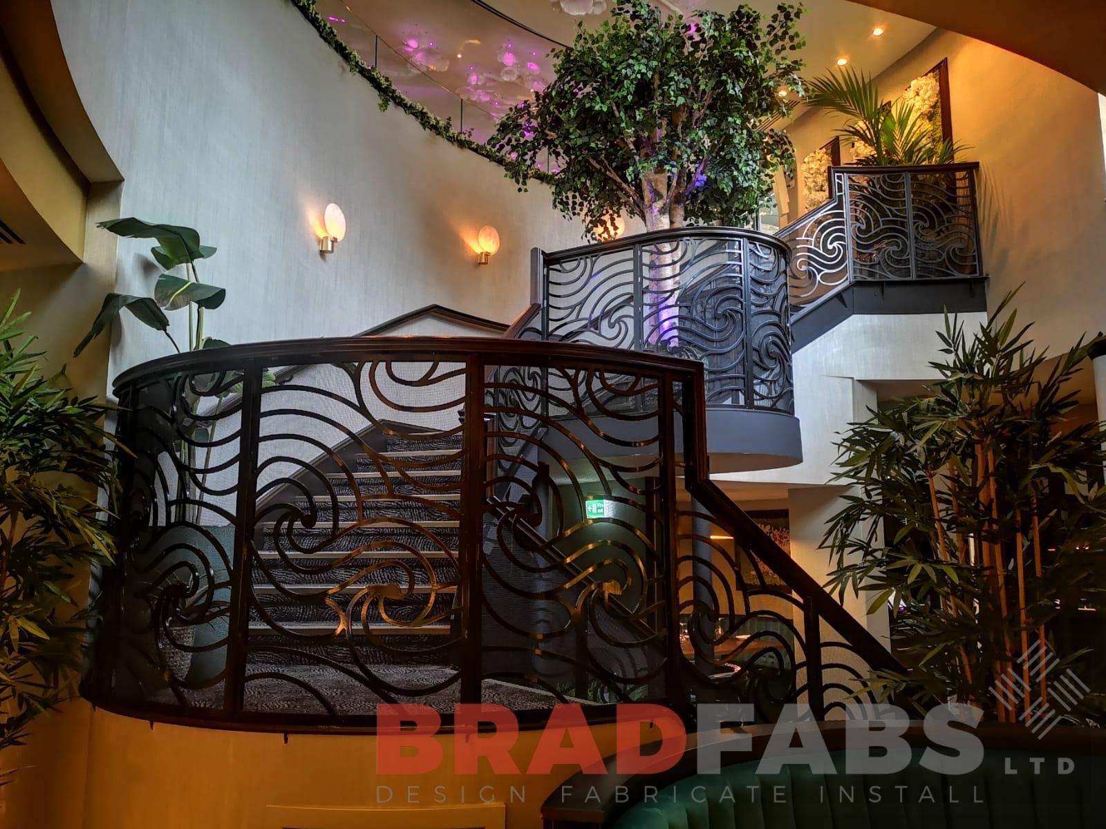 Contemporary Curved helix staircase by Bradfabs
