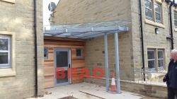 Entrance Glass Canopy installed by Bradfabds