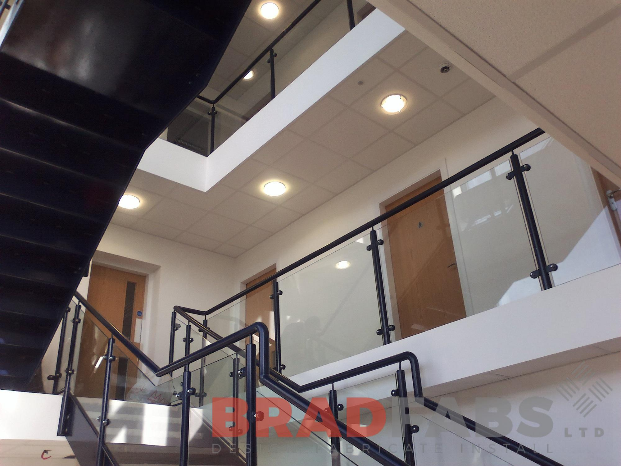 Glass infill pannels with mild steel and powder coated balustrade and handrail