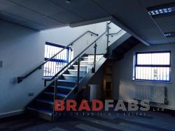 Internal staircase with glass balustrade