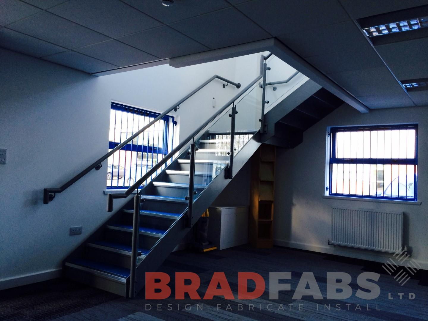 Straight staircase stainless steel balustrade glass infils closed treads
