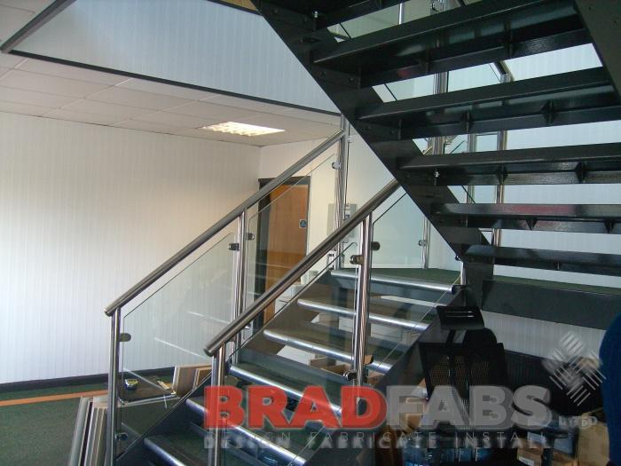 modern office staircase open treads stainless steel handrail glass infil panels