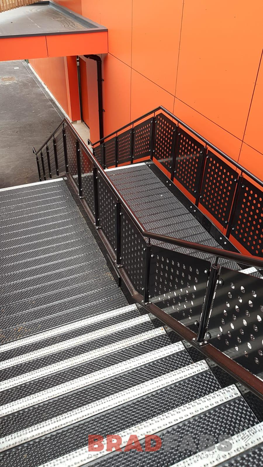 Bradfabs external straight staircase, mild steel, galvanised and powder coated with BNOP5 flooring and laser cut feature balustrade