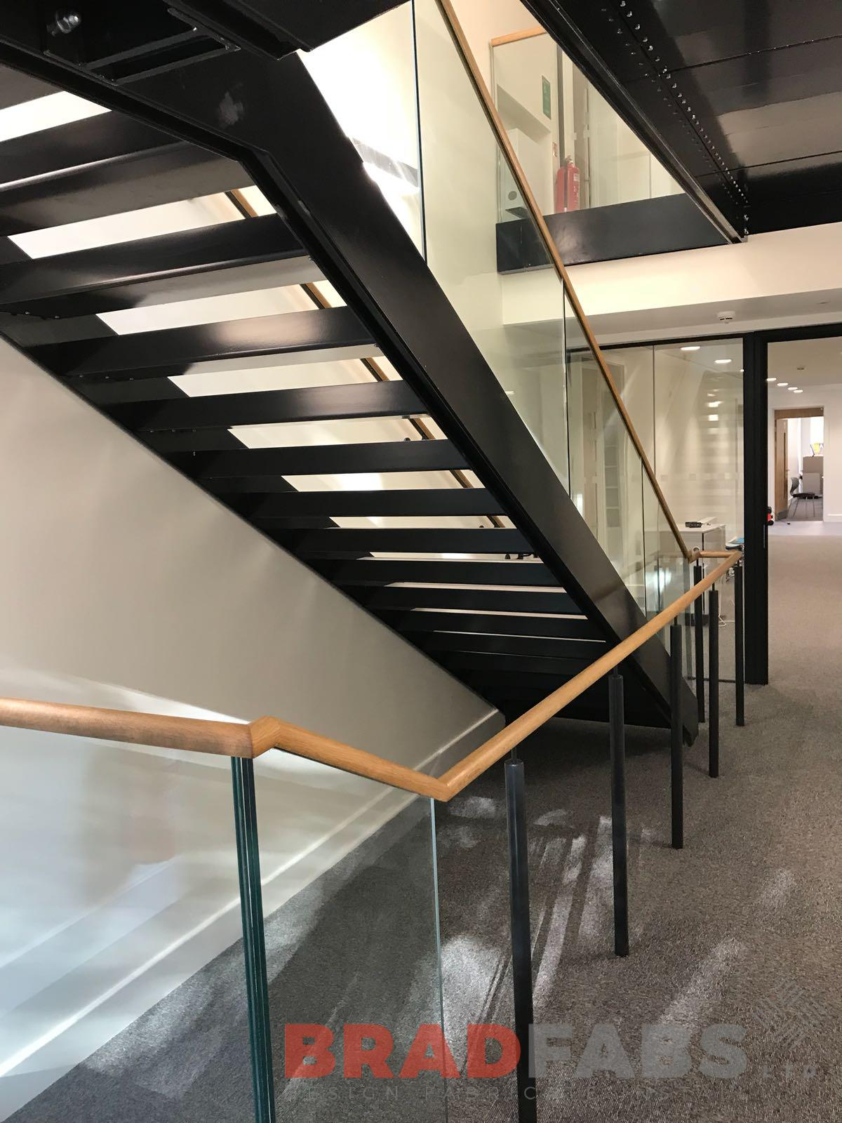 Straight staircase, infinity glass, wooden handrail, open and closed treads, modern, school