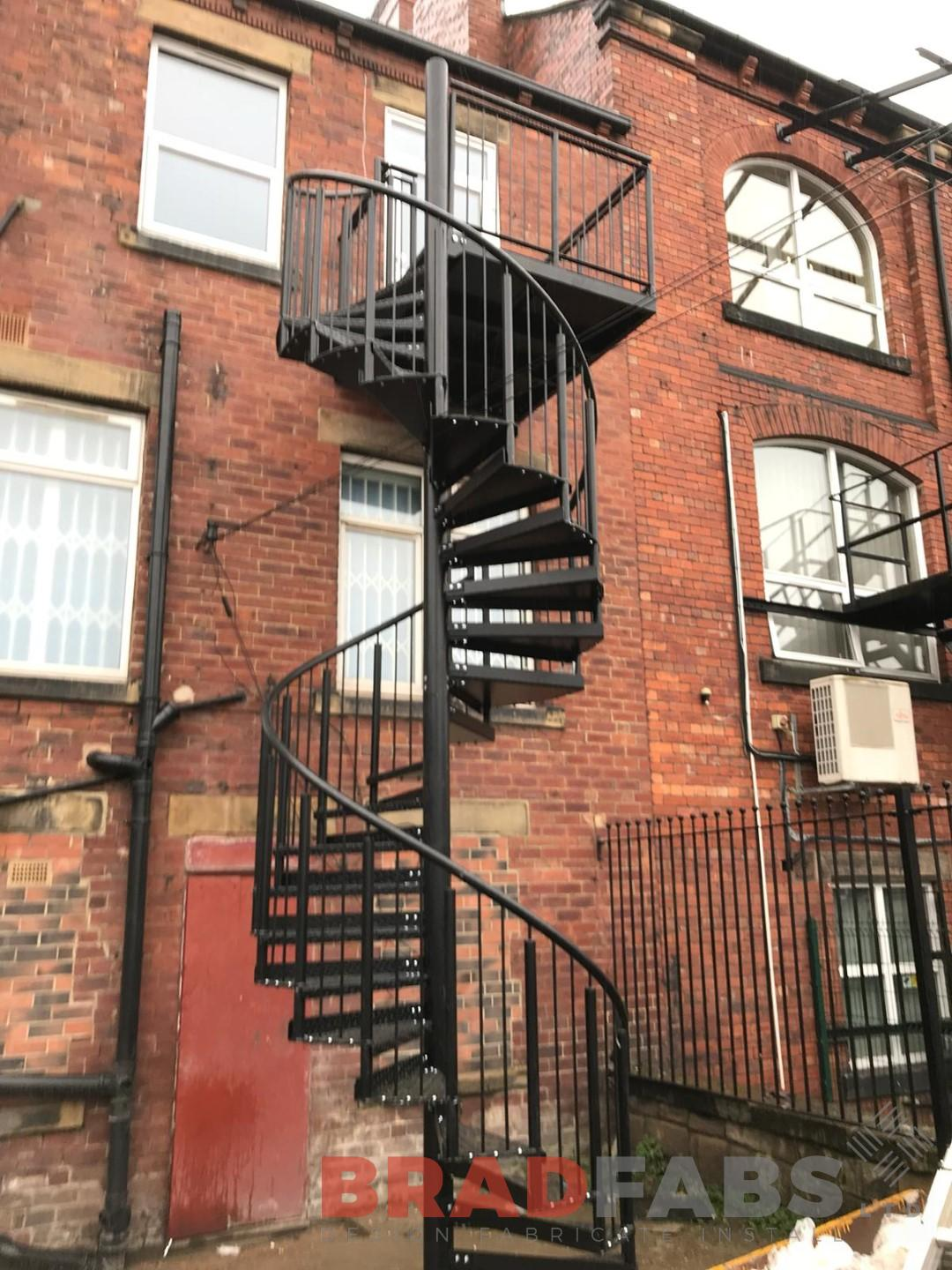 Powder coated black Fire Escape Spiral Staircase installed by Bradfabs