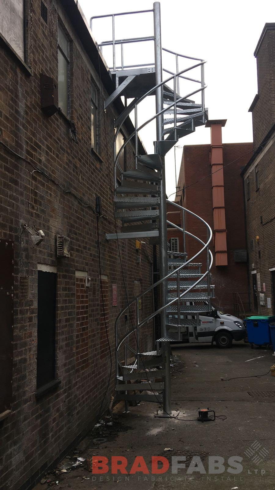 Commercial steel spiral fire escape fabricated by uk leading company Bradfabs