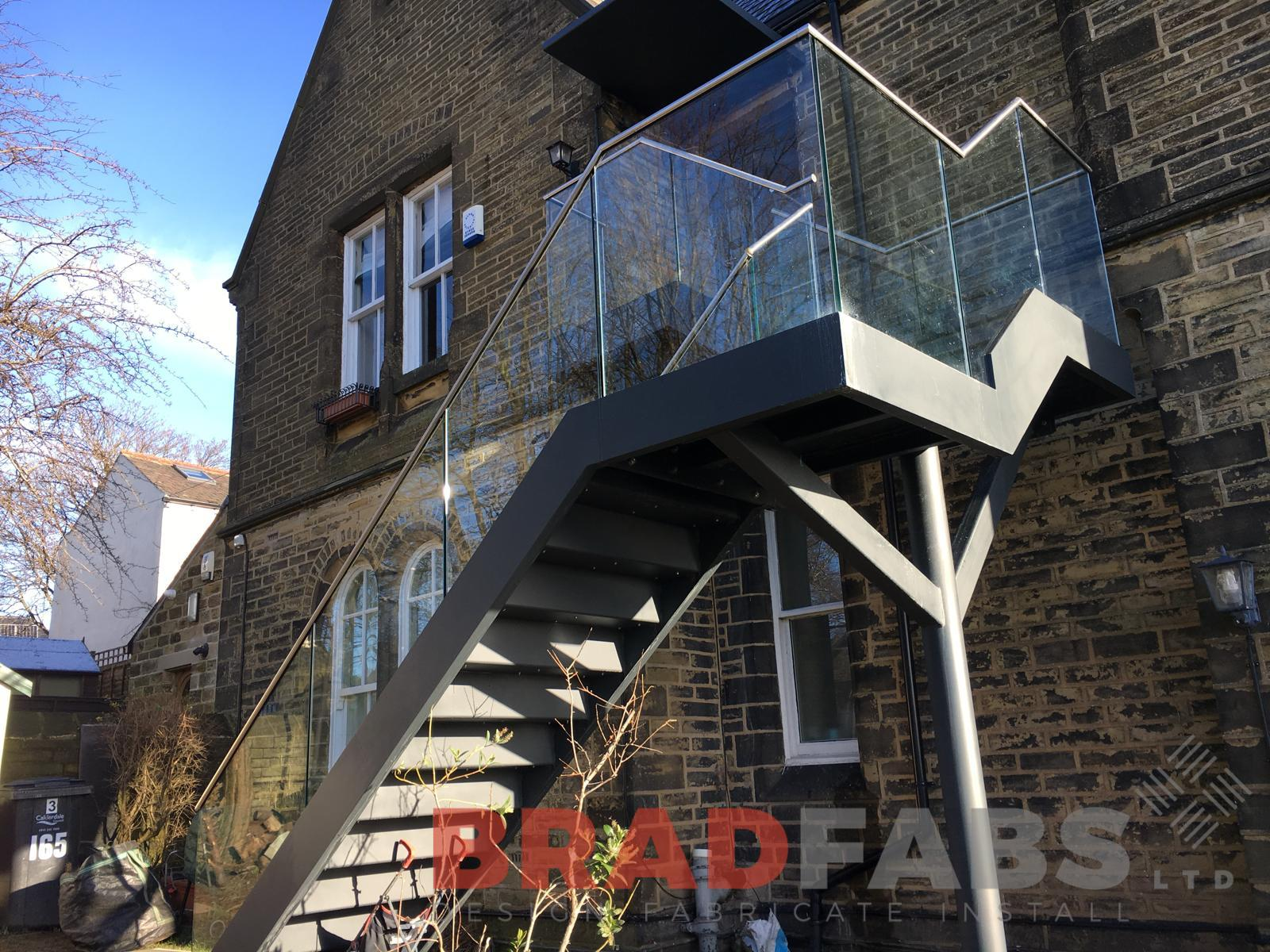 bespoke straight external staircase with infinity glass balustrade and stainless steel handrail, complete with composite decked flooring by Bradfabs Ltd