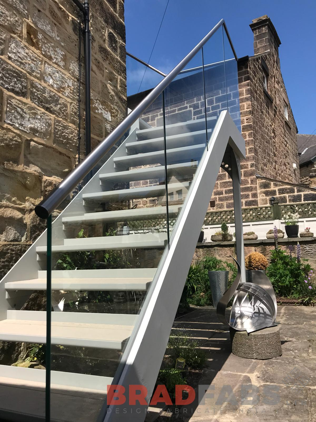 Metal and glass bespoke fire escape by Bradfabs