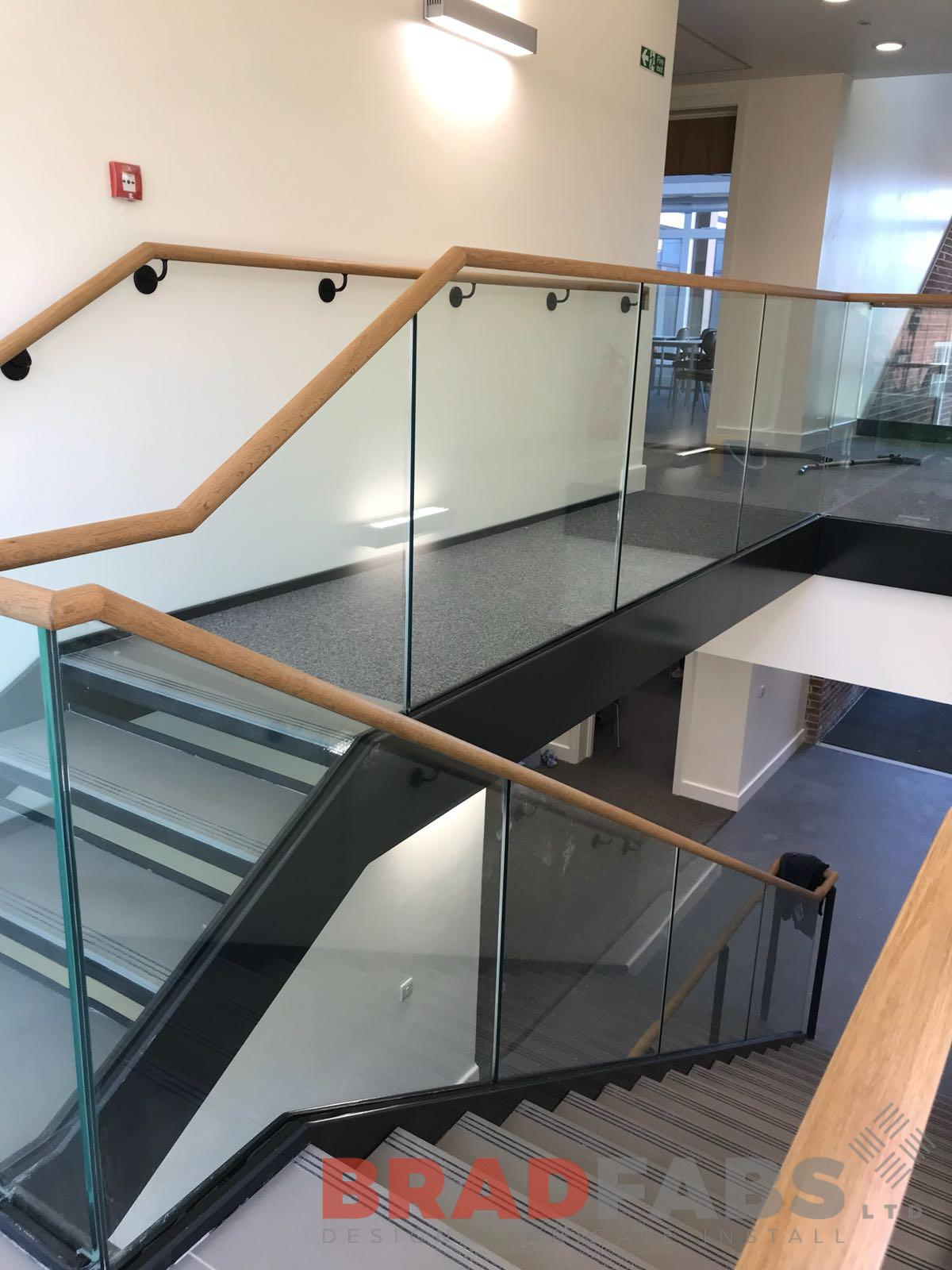 Straight staircase, open and closed treads, wooden handrail, Infinity glass balustrade, modern
