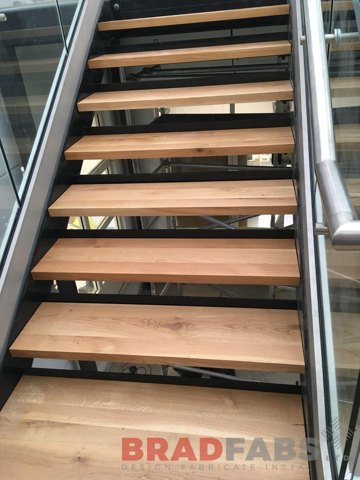 Open oak treads on straight staircase designed, manufactured and installed by Bradfabs