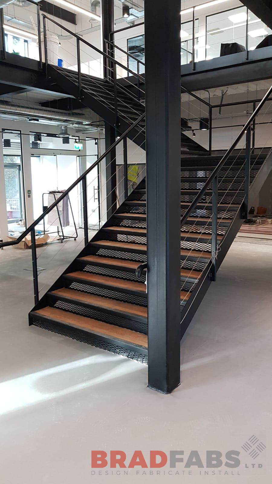 Commercial straight staircase with tension wire