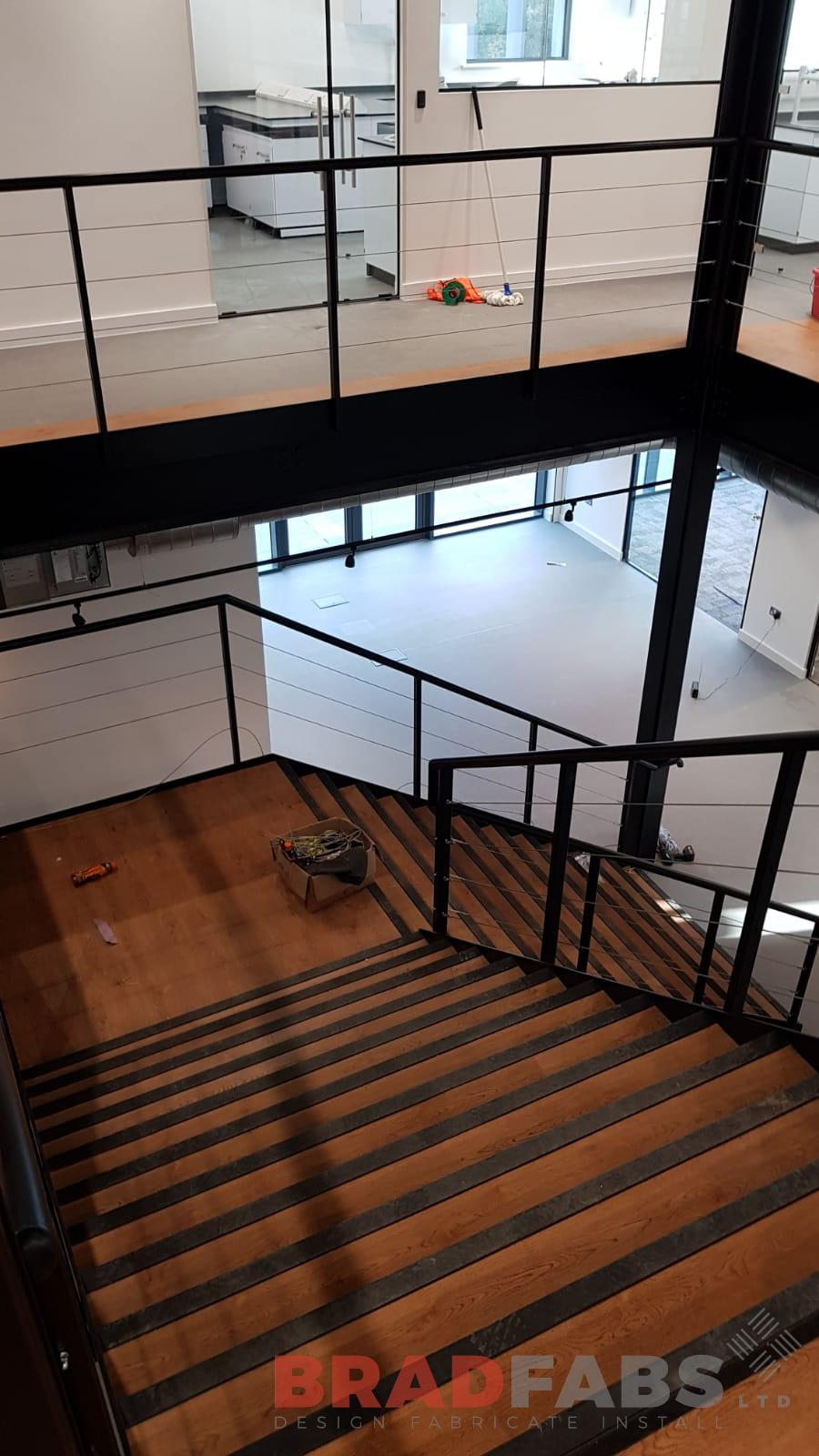 Commercial property staircase, Oak treads, Horizontal balustrade, Mild steel, Powder coated.