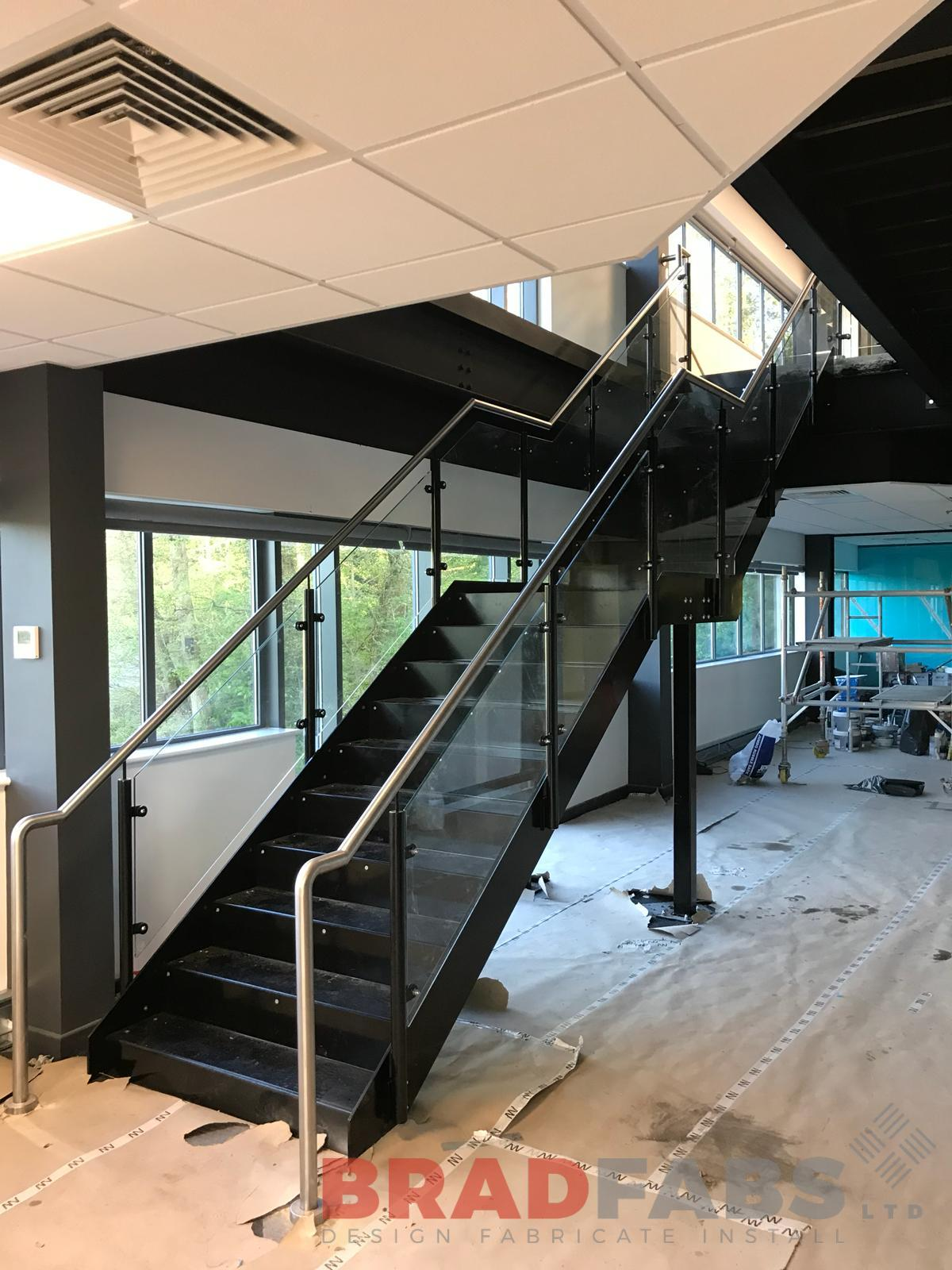 Straight staircase mild steel and powder coated with 10mm toughened safety glass infill panels and stainless steel handrail by Bradfabs