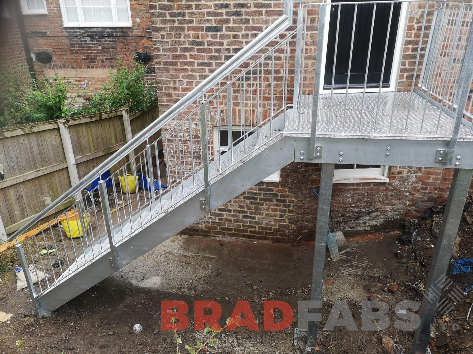 Straight external staircase with vertical bar balustrade and durbar treads by Bradfabs