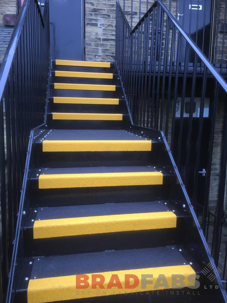 mild steel, galvanised and powder coated external staircase with yellow nosings on the treads by Bradfabs Ltd