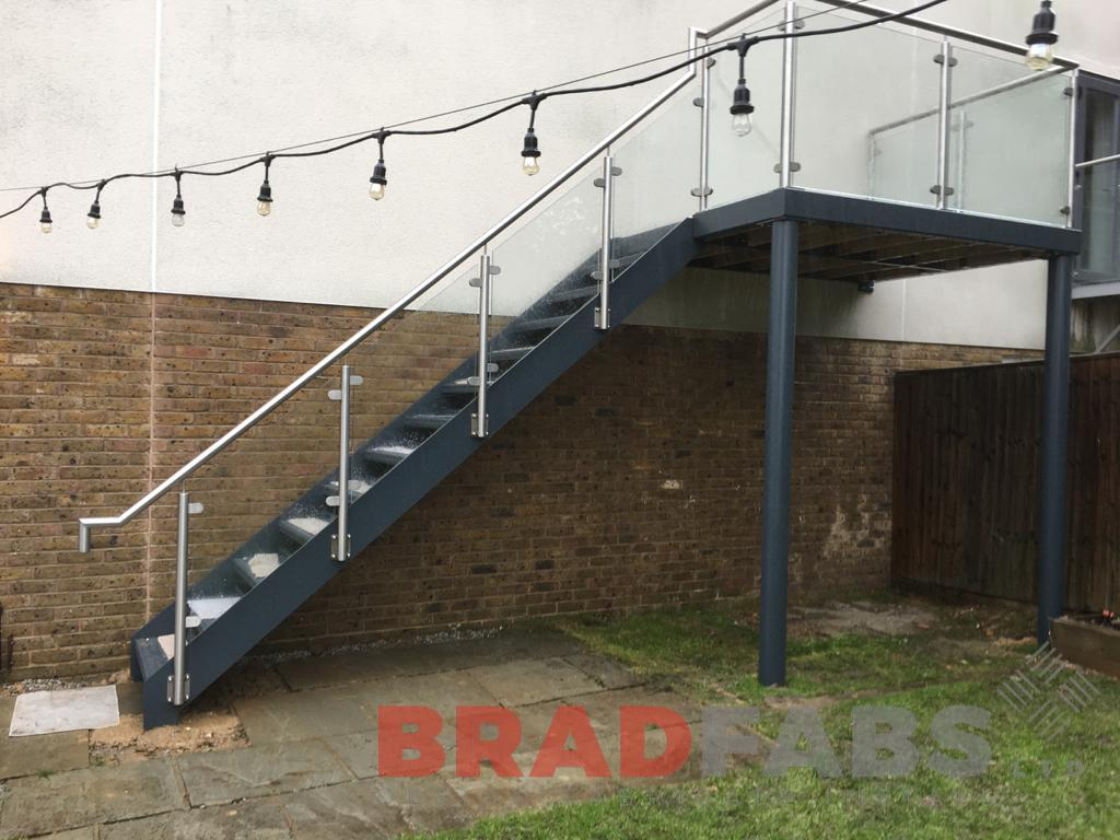 Straight external staircase, stainless steel and glass balustrade by Bradfabs Ltd