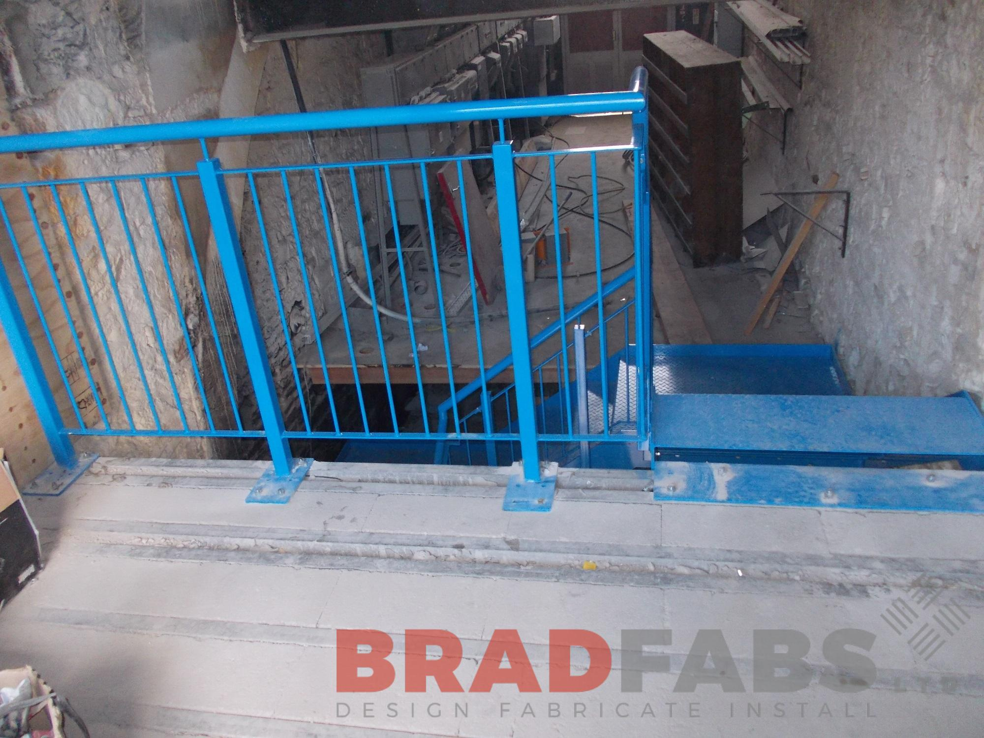 Vertical bar balustrade to the landing at the top of the straight staircase, mild steel and powder coated blue to match by Bradfabs
