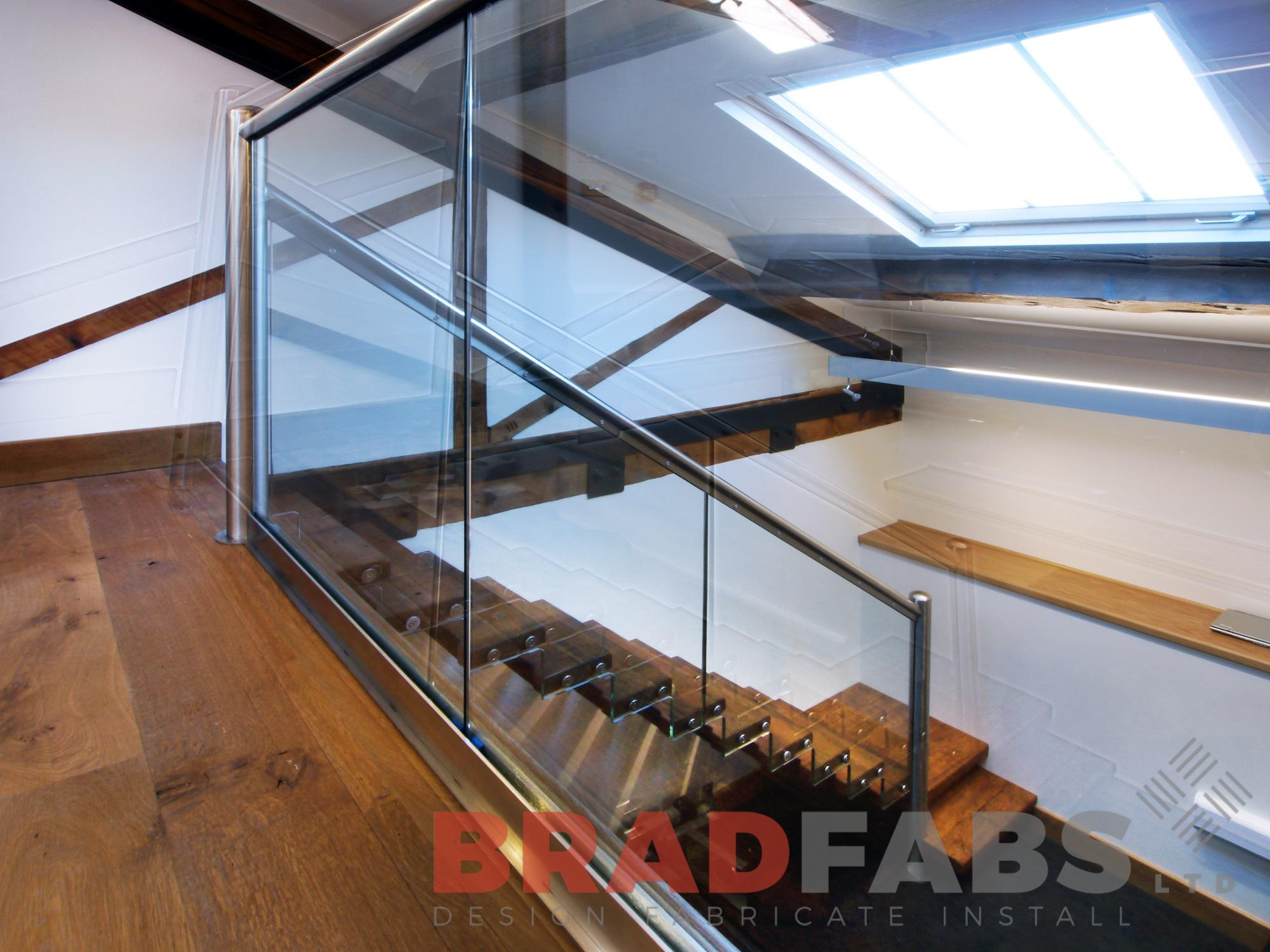 floating effect oak treads stainless steel handrail and glass balustrade