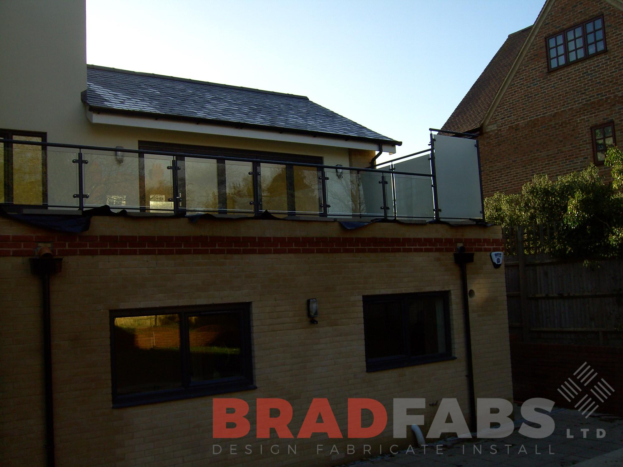 Bradfabs designed and installed this balcony balustrade with privacy glass at a domestic property UK